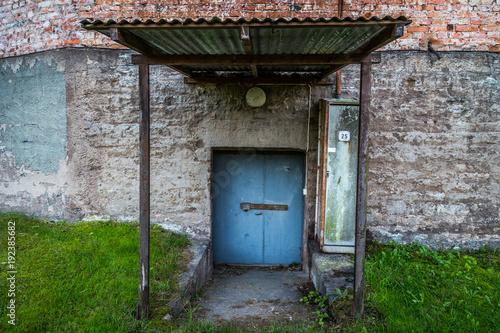 old blue iron door on concrete house