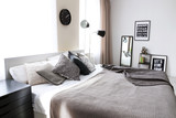 Beautiful modern interior of room with bed - 192385843