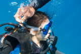 Scuba instructor opened the air valve on wetsuit for immerse - 192394026