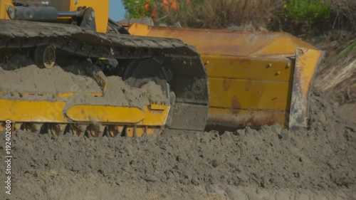 bulldozers on the beach trying to re build sand dunes
