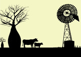 wind mill and cows silhouette