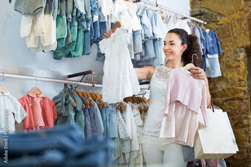 Woman shopping baby dress