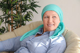 Mature woman with cancer in headscarf indoors - 192419851