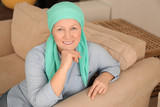 Mature woman with cancer in headscarf indoors - 192419861