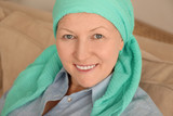 Mature woman with cancer in headscarf indoors - 192419862