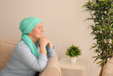 Mature woman with cancer in headscarf indoors - 192419864