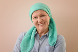 Mature woman with cancer in headscarf on color background - 192419877
