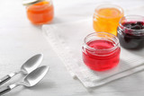 Jars with sweet jams on table - 192420452