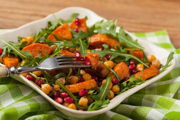 Sweet potato salad with lentils, pomegranates and rocket.