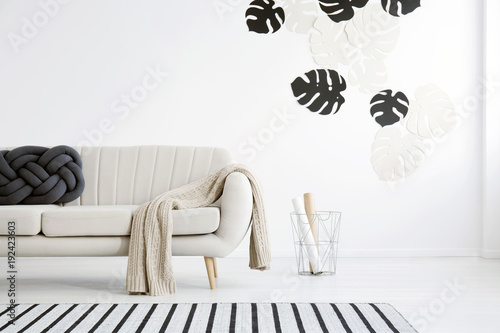 Living room with black leaves