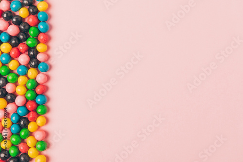 top view of arranged candies isolated on pink