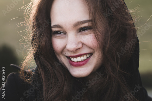 Beautiful smiling woman portrait outdoor. Young cheerful woman smiling. Carefree, happy woman. - 192436643