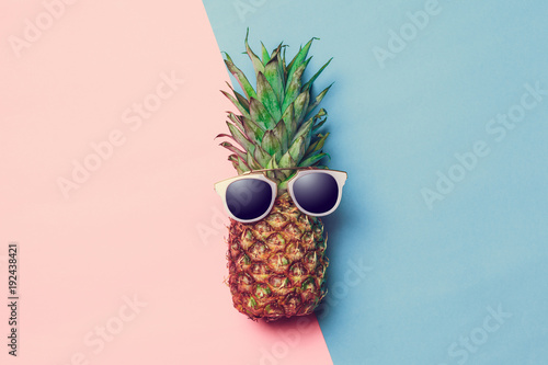 pineapple on colored paper with glasses - 192438421
