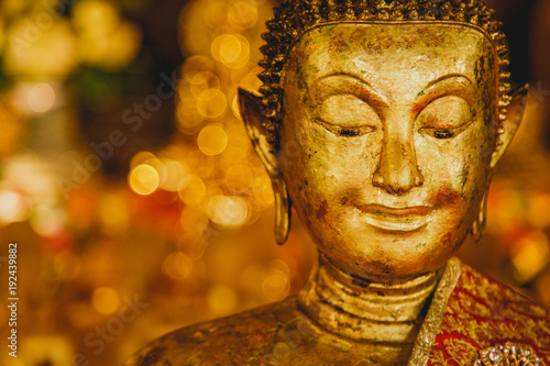 Staande foto Boeddha Smile of the golden Buddha, Face of gold buddha With bokeh background, Thailand, Asia,