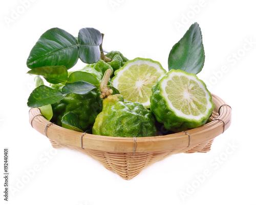 Fotobehang Vruchten fresh bergamot fruit with leaf in bamboo basket isolated on white background