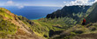 A lone hiker on Kauai's Kalepa Ridge Trail above the panoramic NaPali Coast.