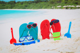 slippers, toys and diving mask at beach - 192444469
