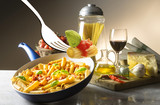 pot with macaroni and tomato sauce on the table - 192447837