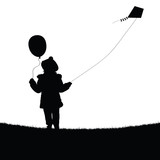 child with balloon and flying dragon silhouette