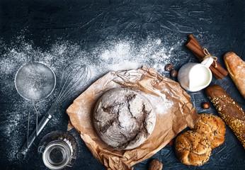 Fresh bread with crispy crust on parchment paper milk flour