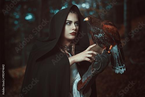 Magician woman with hawk familiar