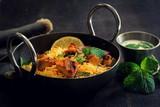 Close up of Homemade Chicken Tikka Biryani served with Raita - 192474856