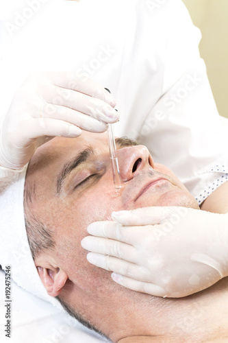 Man in the mask cosmetic procedure in spa salon.