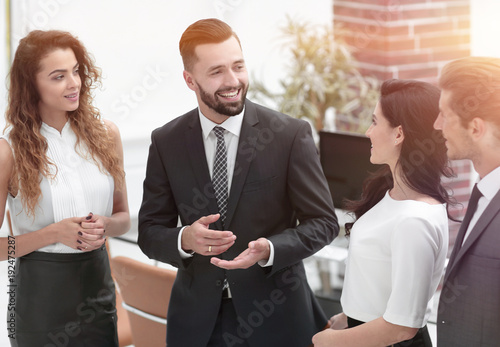 Wall mural smiling business team talking, standing in office