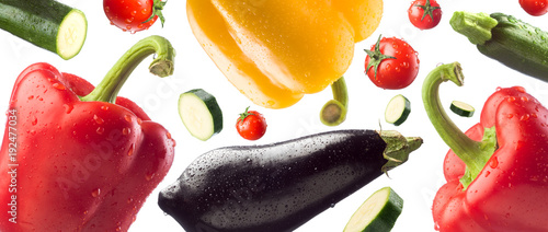 Poster Verse groenten Fresh healthy vegetables falling on white background, healthy eating concept