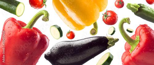 Fotobehang Verse groenten Fresh healthy vegetables falling on white background, healthy eating concept