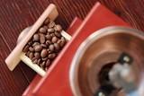 Roasted coffee beans in brown coffee grinder      - 192477491