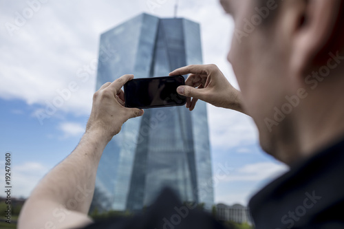 Man Photographing Skyscraper in Frankfurt