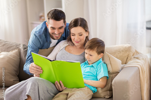 happy family reading book at home - 192480211