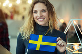 Woman holding a flag of Sweden. - 192482462
