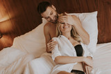 Loving young couple in the bed