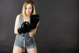 Boxer girl exercise with boxing gloves. - 192490804