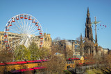 The Christmas Market at Princes Street Gardens Edinburgh Scotland, 2018.  With fairground attractions Big Wheel and Star Flyer - 192492445