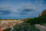 View on the castle Sagunto during sunny day and cloudy sunset - 192495441