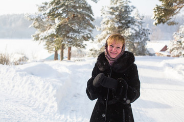 Young woman in the winter at snowy park.