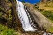 Artsci waterfall - a beautiful waterfall and natural landmark near Stepantsminda (Kazbegi) village, Caucasus mountains, Georgia - 192500205