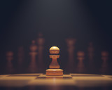 The pawn in highlight. Pieces of chess game, image with shallow depth of field.