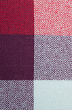 Textured fabric with a pattern of squares of shades of red and purple - 192511647