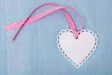 Pink Ribbon with Heart Tag on blue background for Mother's Day, Birthday and Love