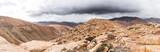 panoramic shot of volcanic mountainous landscape on island of Fuerteventura, Spain und overcast sky