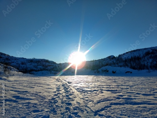 Fotobehang Donkergrijs Winter sun up on the mountain