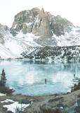 Walking on the frozen Big Pine Lakes beneath Temple Crag
