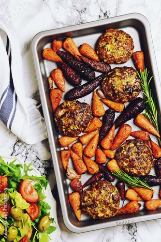 Roasted lamb patties and baby carrots