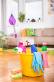 Bucket with cleaning tools in living room - 192531887