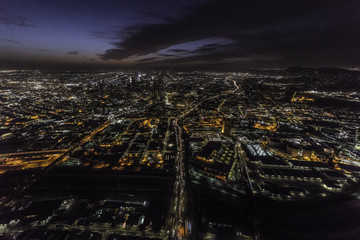 Night aerial view of the Hollywood 101 freeway passing through downtown Los Angeles California.