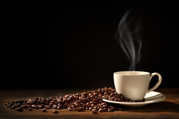 Cup of coffee with smoke and coffee beans on black background, This image with no smoke is available © amenic181